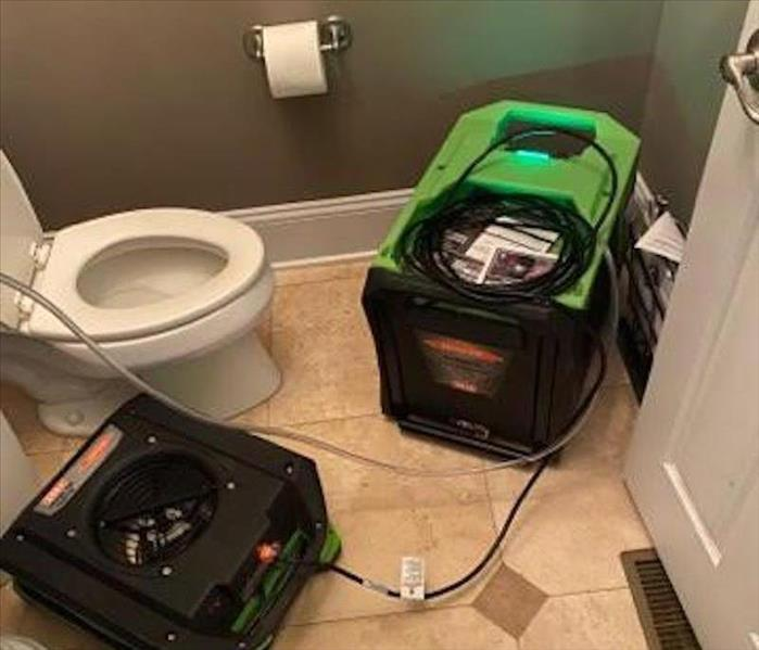 drying equipment in a bathroom for a toilet overflow