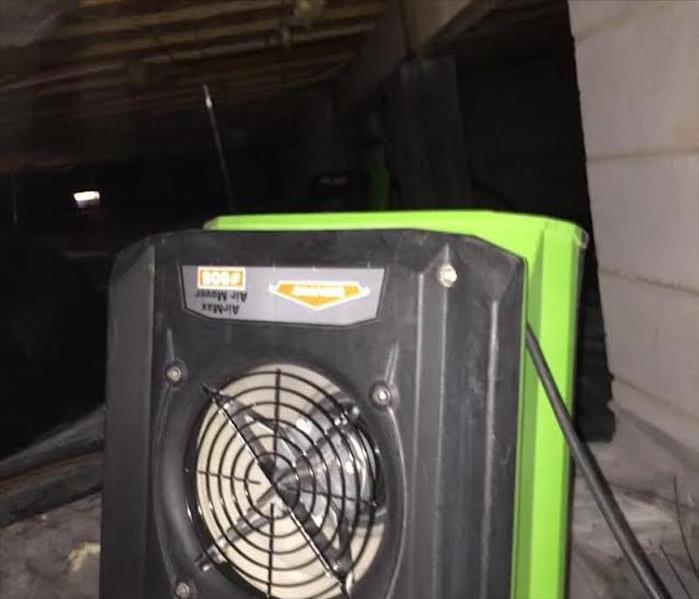 air mover drying a wet crawlspace