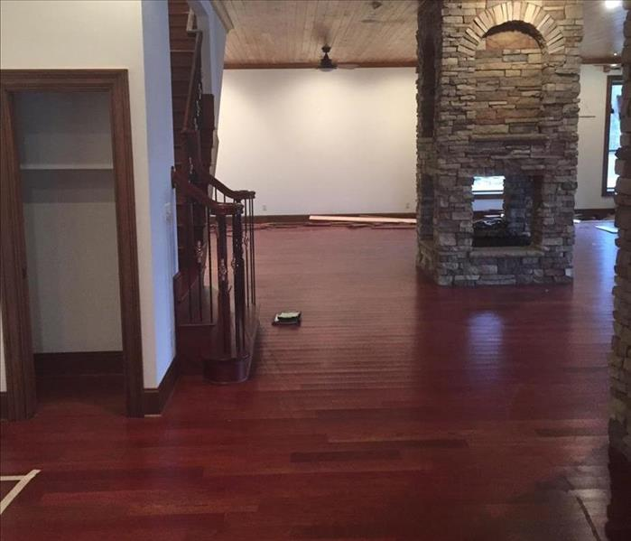 Wood floor in a basement damaged by water